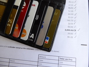Credit cards in wallet on  top of bank statement